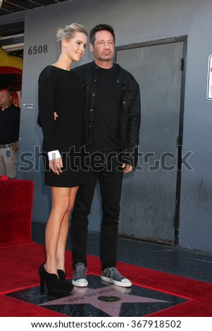 LOS ANGELES - JAN 25:  Claire Holt, David Duchovny at the David Duchovny Hollywood Walk of Fame Star Ceremony at the Fox Theater on January 25, 2016 in Los Angeles, CA - stock photo