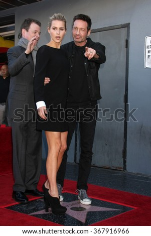 LOS ANGELES - JAN 25:  Claire Holt, John McNamara, David Duchovny at the David Duchovny Hollywood Walk of Fame Star Ceremony at the Fox Theater on January 25, 2016 in Los Angeles, CA - stock photo