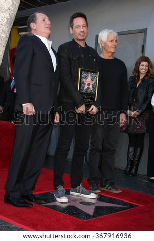 LOS ANGELES - JAN 25:  Garry Shandling, David Duchovny, Chris Carter at the David Duchovny Hollywood Walk of Fame Star Ceremony at the Fox Theater on January 25, 2016 in Los Angeles, CA - stock photo