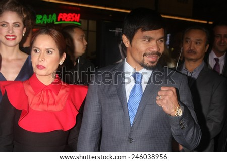 "LOS ANGELES - JAN 20:  Jinkee Pacquiao, Manny Pacquiao at the ""Manny"" Los Angeles Premiere at a TCL Chinese Theater on January 20, 2015 in Los Angeles, CA - stock photo"