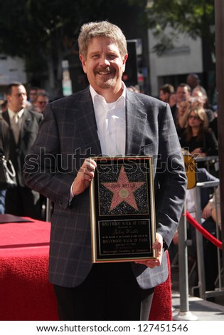 LOS ANGELES - JAN 12:  John Wells arriving to Walk of Fame Ceremony for John Wells  on January 12, 2012 in Hollywood, CA - stock photo