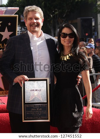 LOS ANGELES - JAN 12: John Wells & Lucy Liu arriving to Walk of Fame Ceremony for John Wells  on January 12, 2012 in Hollywood, CA - stock photo