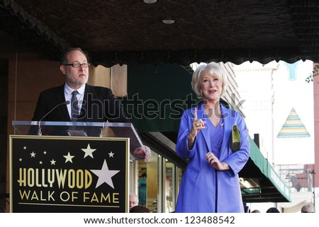 LOS ANGELES - JAN 3: Jon Turtletaub, Helen Mirren at a ceremony as Helen Mirren is honored with star on the Hollywood Walk of Fame on January 3, 2013 in Los Angeles, California - stock photo