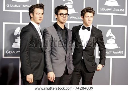 LOS ANGELES - JAN 31:  Jonas Brothers - Kevin Jonas, Joe Jonas and Nick Jonas  arrive at the 52nd Annual GRAMMY Awards held at Staples Center in Los Angeles, California on January 31, 2010. - stock photo