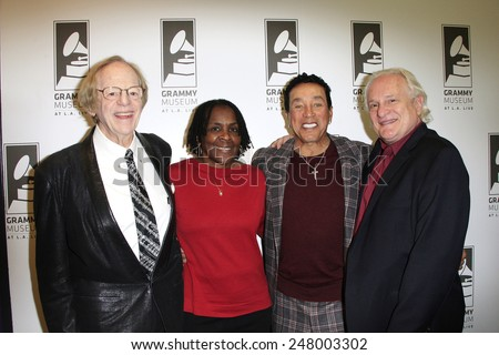 LOS ANGELES - JAN 28: Ken Kragen, Marcia Thomas, Smokey Robinson, Paul Brownstein at the 30th Anniversary of 'We Are The World' at The GRAMMY Museum on January 28, 2015 in Los Angeles, California - stock photo