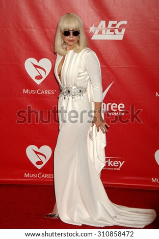 LOS ANGELES - JAN 24:  Lady Gaga arrives at the 2014 MusiCares Person Of The Year Honoring Carole King  on January 24, 2014 in Los Angeles, CA                 - stock photo