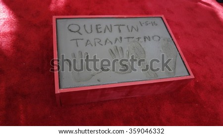 LOS ANGELES - JAN 5: Quentin Tarantino prints at a ceremony as Quentin Tarantino is honored with hand & footprints at the TCL Chinese Theatre IMAX on January 5, 2016 in Los Angeles, CA - stock photo