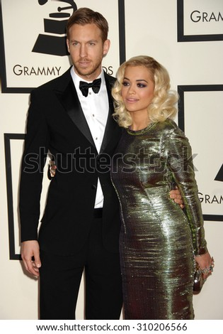 LOS ANGELES - JAN 26:  Rita Ora and Calvin Harris arrives at the 56th Annual Grammy Awards Arrivals  on January 26, 2014 in Los Angeles, CA                 - stock photo