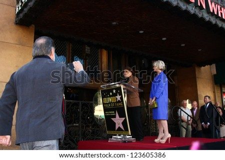 LOS ANGELES - JAN 3:  Taylor Hackford (taking pictures), David Mamet, Helen Mirren at the Hollywood Walk of Fame Star Ceremony for Helen Mirren at Pig 'n Whistle on January 3, 2013 in Los Angeles, CA - stock photo