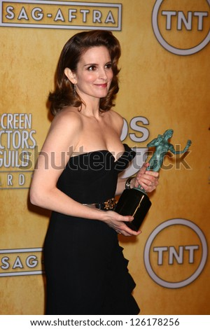 LOS ANGELES - JAN 27:  Tina Fey pose in the press room at the 2013 Screen Actor's Guild Awards at the Shrine Auditorium on January 27, 2013 in Los Angeles, CA - stock photo