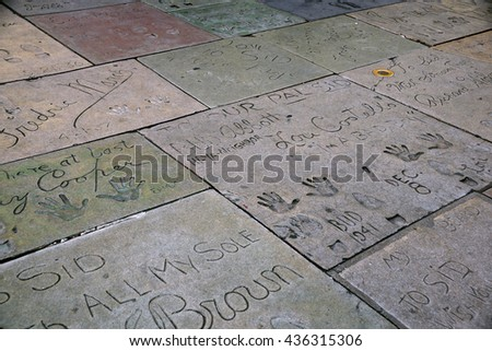 LOS ANGELES - JANUARY 23: Celebrity Hand prints on ground in cement on Hollywood Boulevard January 23, 2014, Los Angeles. Nearly 200 celebrity handprints in the concrete of Chinese Theatre forecourt. - stock photo