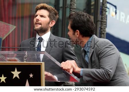 LOS ANGELES - JUL 1:  Adam Scott, Paul Rudd at the Paul Rudd Hollywood Walk of Fame Star Ceremony at the El Capitan Theater Sidewalk on July 1, 2015 in Los Angeles, CA - stock photo