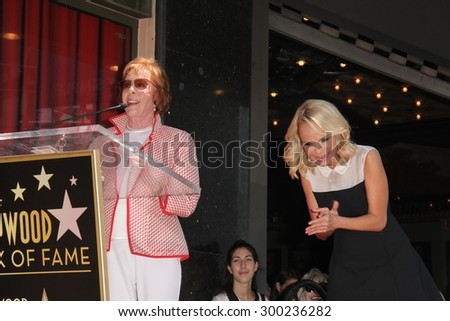 LOS ANGELES - JUL 24:  Carol Burnett, Kristin Chenoweth at the Kristin Chenoweth Hollywood Walk of Fame Star Ceremony at the Hollywood Blvd on July 24, 2015 in Los Angeles, CA - stock photo