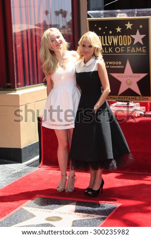 LOS ANGELES - JUL 24:  Dove Cameron, Kristen Chenoweth at the Kristin Chenoweth Hollywood Walk of Fame Star Ceremony at the Hollywood Blvd on July 24, 2015 in Los Angeles, CA - stock photo