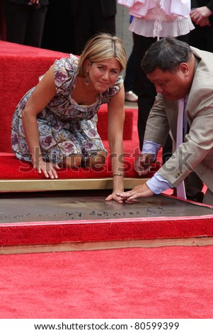 LOS ANGELES - JUL 7: Jennifer Aniston at a ceremony where Jennifer Aniston is honored with hand and foot prints at Grauman's Chinese Theater in Los Angeles, California on July 7, 2011