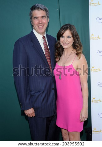 """LOS ANGELES - JUL 08:  Kellie Martin & Keith Christian arrives to the Hallmark's """"Northpole Christmas Celebration""""  on July 08, 2014 in Beverly Hills, CA                 - stock photo"""