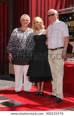 LOS ANGELES - JUL 24:  Kristin Chenoweth, parents at the Kristin Chenoweth Hollywood Walk of Fame Star Ceremony at the Hollywood Blvd on July 24, 2015 in Los Angeles, CA - stock photo