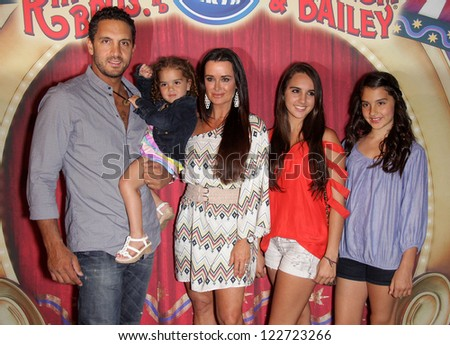 "LOS ANGELES - JUL 21:  KYLE RICHARDS & FAMILY arriving to Ringling Bros Presents ""Fully Charged""  on July 21, 2011 in Los Angeles, CA"