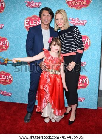 "LOS ANGELES - JUL 16:  Lou Diamond Phillips, Yvonne Boismier & Indigo Sanara Phillips arrives to ""Elena of Avalor"" Los Angeles Premiere on July 16, 2016 in Beverly Hills, CA                 - stock photo"