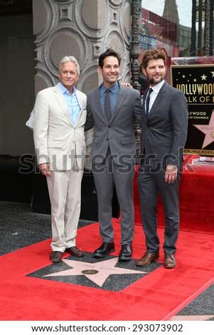 LOS ANGELES - JUL 1:  Michael Douglas, Paul Rudd, Adam Scott at the Paul Rudd Hollywood Walk of Fame Star Ceremony at the El Capitan Theater Sidewalk on July 1, 2015 in Los Angeles, CA - stock photo