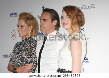 "LOS ANGELES - JUL 9:  Parker Posey, Joaquin Phoenix, Emma Stone at the ""Irrational Man"" Los Angeles Premiere at the Writer's Guild of America Theater on July 9, 2015 in Beverly Hills, CA  - stock photo"