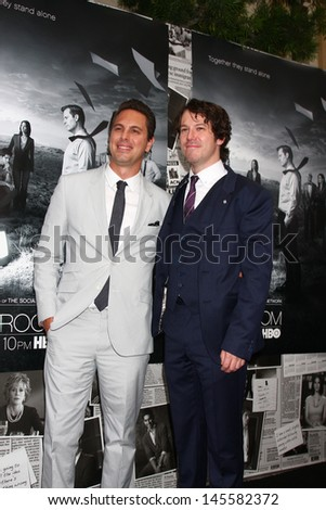 """LOS ANGELES - JUL 10:  Thomas Sadoski. Johnny Gallagher Jr. arrives at the HBO series """"The Newsroom"""" Season 2 Premiere Screening at the Paramount Theater on July 10, 2013 in Los Angeles, CA - stock photo"""