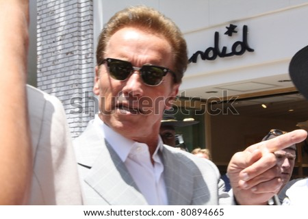 LOS ANGELES - JULY 12: Ex-governor Arnold Schwarzenegger at The Grove for lunch July 12, 2011 Los Angeles, CA. - stock photo