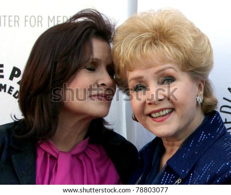 LOS ANGELES - JUN 7:  Carrie Fisher, Debbie Reynolds arrive at the Debbie Reynolds Collection Auction Preview at Paley Center For Media on June 7, 2011 in Beverly Hills, CA - stock photo