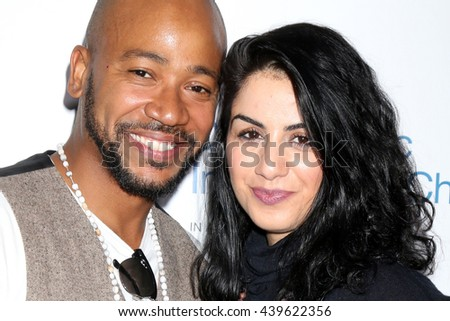 LOS ANGELES - JUN 18: Columbus Short, fiance Aida Abramyan at the Stand For Kids Gala at the Twentieth Century Fox Studios Lot on  ,  June 18, 2016 in Century City, CA - stock photo