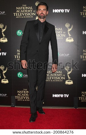 LOS ANGELES - JUN 22:  Jason Thompson at the 2014 Daytime Emmy Awards Arrivals at the Beverly Hilton Hotel on June 22, 2014 in Beverly Hills, CA - stock photo