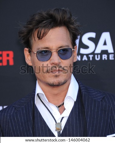LOS ANGELES - JUN 22:  Johnny Depp arrives to the 'The Lone Ranger' Hollywood Premiere  on June 22, 2013 in Hollywood, CA                 - stock photo