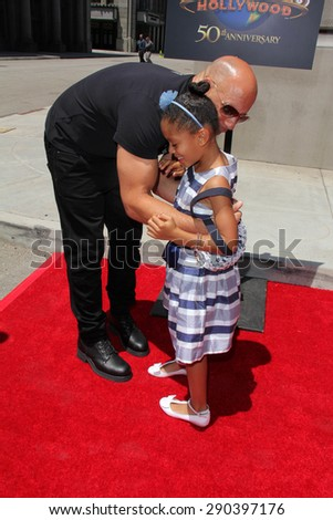 "LOS ANGELES - JUN 23:  Vin Diesel, Tyrese Gibson's daughter at the ""Fast & Furious - Supercharged"" Ride Press Event at the Universal Studios on June 23, 2015 in Universal City, CA"