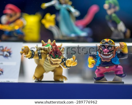 LOS ANGELES - June 16, 2015: Bowser and Wario skylanders style Amiibo figures on display at E3 2015 expo. Electronic Entertainment Expo is an annual trade fair for the video game industry. - stock photo