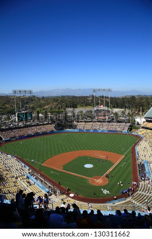 LOS ANGELES - JUNE 30: Classic view of Dodger Stadium before a sunny day baseball game on June 30, 2012 in Los Angeles, California. Dodger Stadium opened in 1962 and cost $23 million. - stock photo