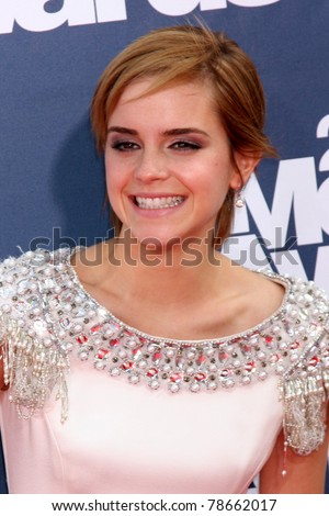 LOS ANGELES - JUNE 5:  Emma Watson arrives at the the 2011 MTV Movie Awards at Gibson Ampitheatre on June 5, 2011 in Los Angeles, CA