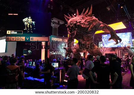 LOS ANGELES - JUNE 12: giant monster promoting Evolve at 2k booth at E3 2014, the Expo for video games on June 12, 2014 in Los Angeles - stock photo