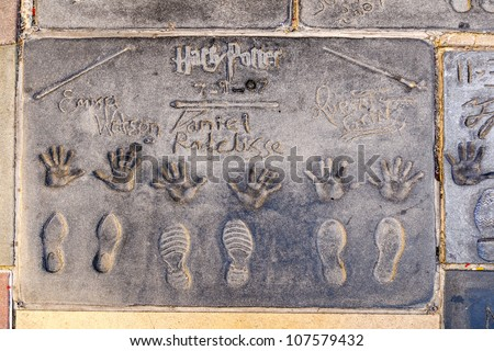 LOS ANGELES - JUNE 26:  handprint of Harry Potterâ??s cast in Hollywood Boulevard on June 26,2012 in Los Angeles. There are nearly 200 celebrity handprints in the concrete of Chinese Theatre's forecourt - stock photo