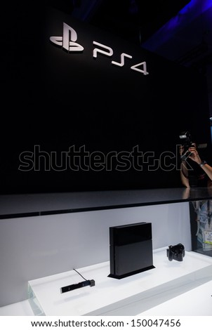 LOS ANGELES - JUNE 11: Sony unveiling PlayStation 4 retail design for the first time at E3 2013, the Expo for video games on June 11, 2013 in Los Angeles - stock photo