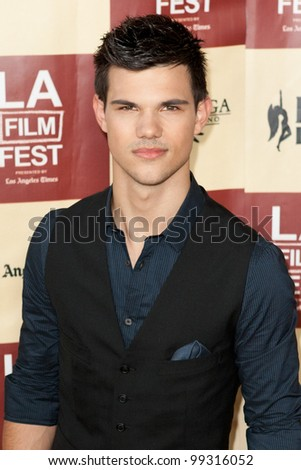 LOS ANGELES - JUNE 21: Taylor Lautner arrives at the Los Angeles Film festival premiere of 'A Better Life' on June 21 2011 in Los Angeles, CA - stock photo