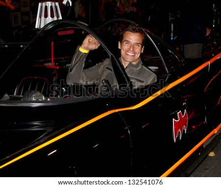 LOS ANGELES - MAR 21:  Antonio Sabato Jr. in the Batmobile at the Batman Product Line Launch at the Meltdown Comics on March 21, 2013 in Los Angeles, CA - stock photo