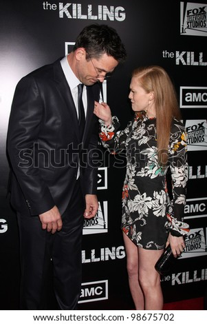 """LOS ANGELES - MAR 26:  Billy Campbell, Mireille Enos arrives at  the AMC's """"The Killing"""" Season 2 Premiere at the ArcLight Theaters on March 26, 2012 in Los Angeles, CA - stock photo"""