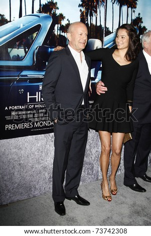 LOS ANGELES - MAR 22:  Bruce Willis, wife Emma Heming arrive at the Los Angeles HBO Premiere of 'His Way' at Paramount Studios in Los Angeles, California on March 22, 2011.