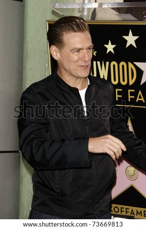 LOS ANGELES - MAR 21:  Bryan Adams Bryan Adams is honored with a star on the Hollywood Walk of Fame at Hollywood Walk of Fame on March 21, 2011 in Los Angeles, CA - stock photo