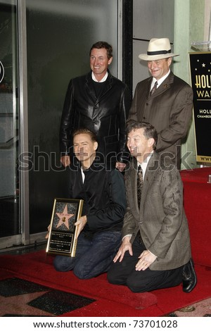 LOS ANGELES - MAR 21: Bryan Adams, Leron Gubler, Wayne Gretzky, Sam Smith at a ceremony where Bryan Adams is honored with a star on the Hollywood Walk of Fame in Los Angeles, CA on March 21, 2011. - stock photo