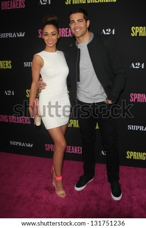 "LOS ANGELES - MAR 14:  Cara Santana, Jesse Metcalfe arrives at the 'Spring Breakers"" Premiere at the Arclight, Hollywood on March 14, 2013 in Los Angeles, CA - stock photo"