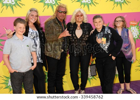 LOS ANGELES - MAR 23 - Duane Chapman, aka Dog the Bounty Hunter and family arrives at the Nickelodeons 2013 Kids Choice Awards on March 23,  2013 in Los Angeles, CA              - stock photo