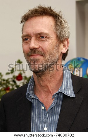 "LOS ANGELES - MAR 27:  Hugh Laurie arriving at the ""HOP"" World Premiere at Universal Studios Hollywood on March 27, 2011 in Los Angeles, CA - stock photo"