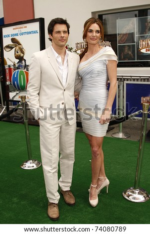 """LOS ANGELES - MAR 27:  James Marsden, wife Lisa Linde arriving at the """"HOP"""" World Premiere at Universal Studios Hollywood on March 27, 2011 in Los Angeles, CA - stock photo"""