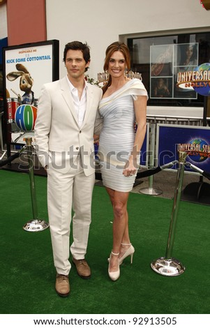 LOS ANGELES - MAR 27:  James Marsden, wife Lisa Linde arriving at the World Premiere of 'HOP' held at Universal Studios Hollywood in Los Angeles, California on March 27, 2011. - stock photo