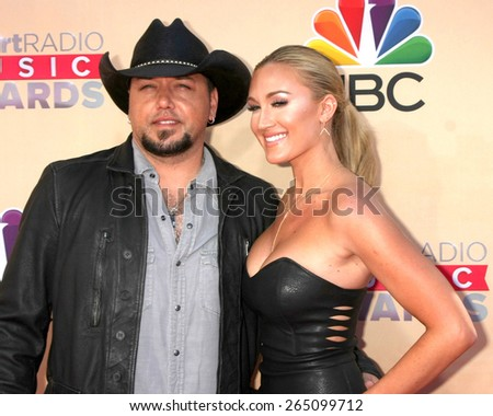 LOS ANGELES - MAR 29:  Jason Aldean, Brittany Kerr at the 2015 iHeartRadio Music Awards at the Shrine Auditorium on March 29, 2015 in Los Angeles, CA - stock photo